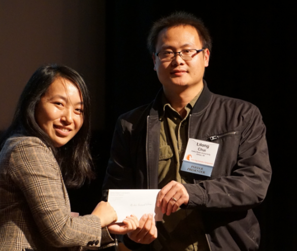Dr. Sato shakes hands with Dr. Lilong Chai in presentation of poster contest award.
